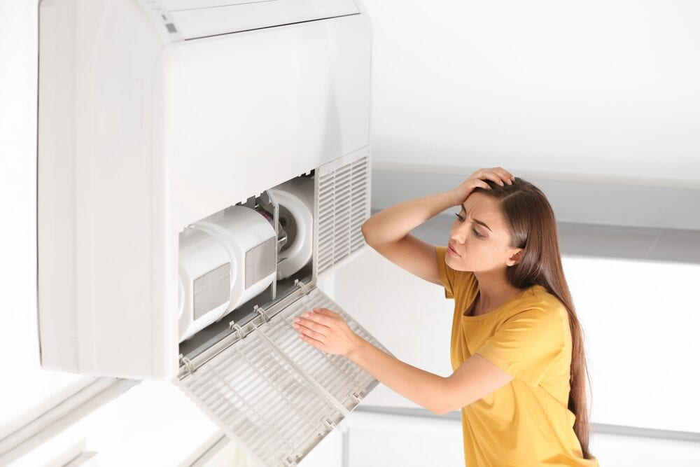 woman-worries-about-broken-air-conditioner