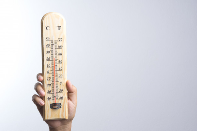 hand-holding-classic-thermometer_